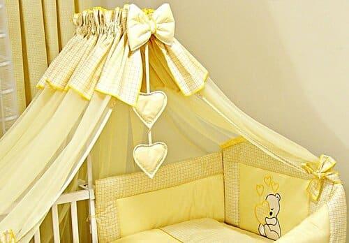 Ciel de lit bébé jaune pour berceau